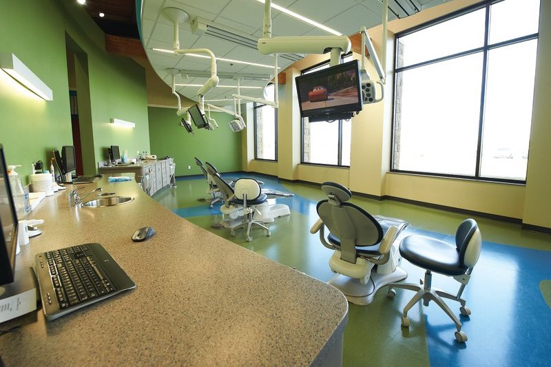 Dental cleaning room with chairs and monitors at Tiny Teeth Pediatric Dentistry